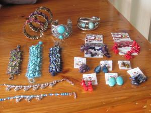 Lots of fancy and really 'cheap' jewellery. Note the large, chunky bracelets!