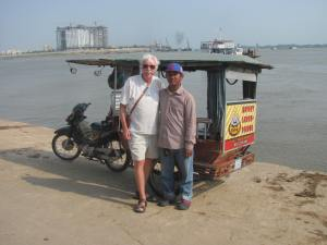 Graham with one of our friendly tuk- tuk drivers.