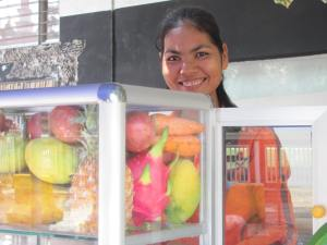 A friendly English-speaking entrepreneur selling delicious fruit shakes.