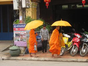 Monks doing their morning rounds for food or a donation.