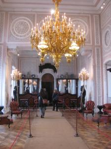 The palace living room with chandelier.