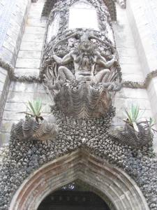 One of the many gargoyles adorning the doorways of the palace.