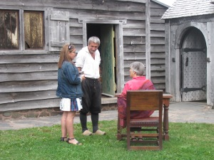 Inside the Habitation with  Mr. Melanson, an Acadian guide, dressed in period costume.