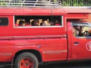 Children going to school in a songtao.
