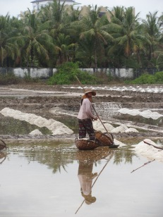 Woman working in the salt fields.