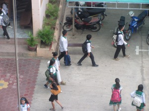 Students heading to class at the NGO school next to my hotel.