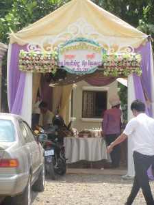Preparing the tent for a Cambodian wedding.