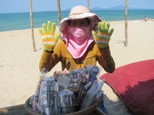 Viet Nam lady dressed for the sun at the beach!
