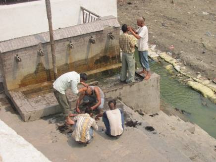 Preparing for a cremation on the banks of the Bagmati River.