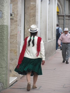 An indigenous woman in Cuenca. She has two braids whereas in Otavalo the women only wore one.