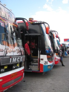 Buses at the ready at Otavalo's bus station.