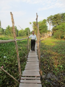 Wooden bridge to the |Cham village.