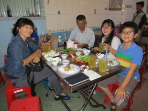 Mr. Long with mother, Trinh and her daughter and son, two of Long's student's.