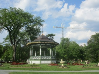 The Gardens bandstand with another crane in the background.