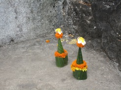 Little gifts made of marigold and bamboo leaves for Buddha.
