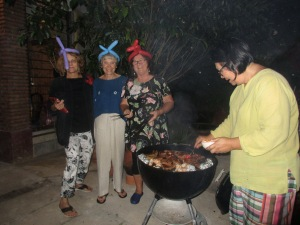 The gals hamming it up while Toi barbecues our dinner
