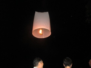 The lantern floats up after wishes have been made