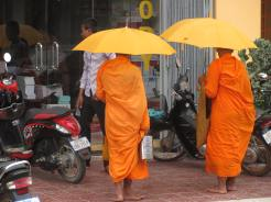 Monks looking for breakfast offering from local merchants.