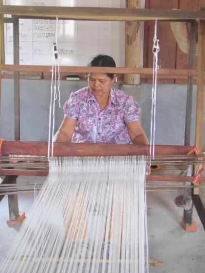 Local woman weaving scarves at Meas Homestay.