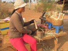 Vender selling sugar cane.